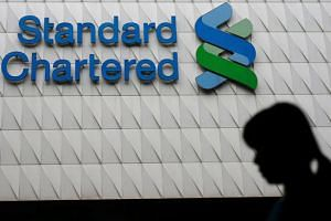 A file picture of Standard Chartered logo at its headquarters in Hong Kong, China. PHOTO: REUTERS