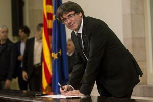 Catalan leader Carles Puigdemont has said he would seek to break away from Spain but stopped short of a unilateral declaration of independence.