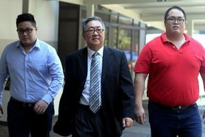 ISenior Counsel Tan Chee Meng (centre) said he and his wife decided that moving to Canada was best for their sons Isaac (left) and Jonathan.