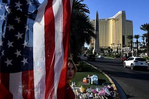 The US flag is left at a makeshift memorial outside the Route 91 music festival site beside the Mandalay Hotel, on Oct 4, 2017. Clark County Sheriff Joseph Lombardo did not address whether the mass shooting could have been prevented based on the new
