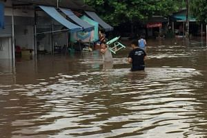 The affected residents were awoken at around 4am as floodwaters from the swollen Mae Tha Chang River flooded their homes.