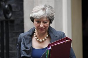 "British Prime Minister Theresa May told parliament on Monday it was up to the European Union to move talks to the next phase, saying: ""the ball is in their court""."