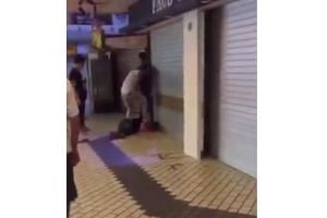 A clip that has been going viral on social media shows a man lying on the floor outside a shuttered shop, while another man wearing a white top is seen stomping on him.