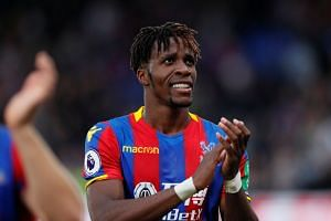 Crystal Palace's Wilfried Zaha applauds fans after the match.