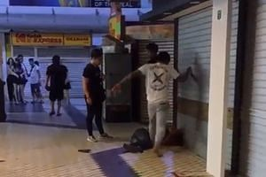 The man in the white top is seen stomping on the victim's face repeatedly in the video. He punches another man standing nearby when the latter appears to try to intervene.