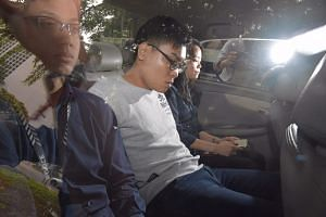 Wee Boon How (centre), 22, was accused of punching and stamping on Mr Bong Heng Yun's face multiple times, causing multiple facial fractures on the latter's face. Wee has been granted bail of $20,000.