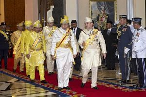 Malaysia's rulers coming out from a meeting last December in Kuala Lumpur led by Selangor Sultan Sharafuddin Idris Shah (front, left) and Sultan Muhammad V from Kelantan, the current Malaysian King.