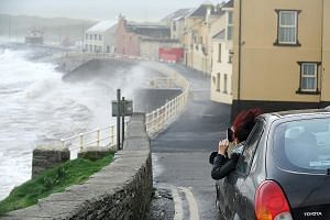 As Ophelia battered the Atlantic coast of Ireland in Lahinch village, County Clare, yesterday, Britain's met service put an Amber Weather Warning into effect for Northern Ireland, saying the storm posed a danger to life.