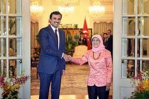 The Emir of Qatar, His Highness Sheikh Tamim Bin Hamad Al Thani, calls on President Halimah Yacob at the Istana on Oct 17, 2017 during a state visit.
