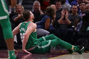 Gordon Hayward of the Boston Celtics sitting on the floor after being injured while playing against the Cleveland Cavaliers at Quicken Loans Arena on Oct 17, 2017, in Cleveland, Ohio.