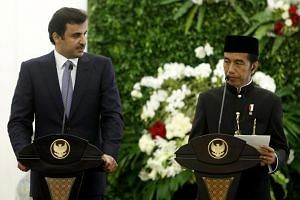(From left)  Emir of Qatar Sheikh Tamim bin Hamad al-Thani and Indonesian President Joko Widodo speak during a joint press conference at the Presidential Palace in Bogor, Indonesia on Oct 18, 2017.