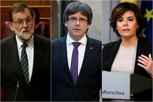 (From left) Spain's prime minister Mariano Rajoy, President of Catalonia Carles Puigdemont and Spain's deputy prime minister Soraya Saenz de Santamaria.