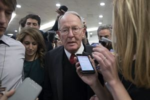 Lamar Alexander (centre) speaks with members of the news media on Capitol Hill in Washington, Oct 19, 2017.