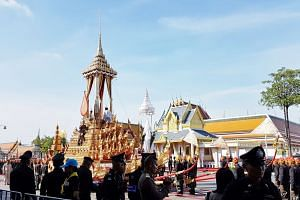 In an Oct 15 rehearsal for the Thai royal cremation. a duplicate royal urn is transferred from the palanquin to the Great Victory Chariot.