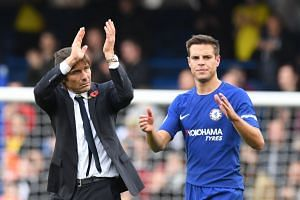 Chelsea manager Antonio Conte (left) and player Cesar Azpilicueta applaud supporters at the end of the match against Watford.