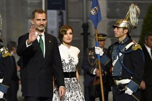Spain's King Felipe and Queen Letizia leave the 2017 Princess of Asturias Awards in Oviedo, Spain, Oct 20, 2017.