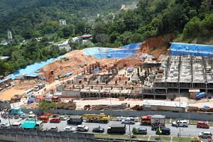 Penang Chief Minister Lim Guan Eng called for a state inquiry into a landslide that killed three people and left 11 missing at a housing construction site on Oct 21, 2017.