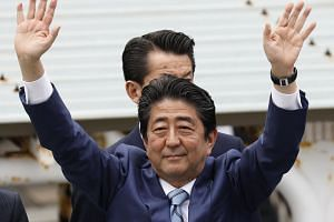 Japanese PM Shinzo Abe waving to voters after delivering a campaign speech in Fujisawa, south of Tokyo, on Oct 20, 2017.