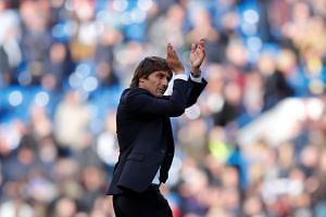 Chelsea manager Antonio Conte applauds fans after the match.