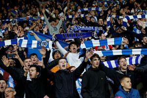 Huddersfield Town fans celebrate at the end of the match at the John Smith's stadium in northern England after the team's first win over United in 65 years.