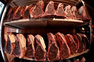 Cuts of USDA prime beef being dry-aged in the lobby of Gallaghers steakhouse in the Manhattan borough of New York.