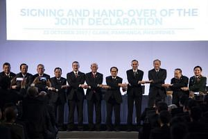 The Association of Southeast Asian Nations Defence Ministers at the 11th ASEAN Defence Ministers' Meeting opening ceremony in Clark, east of Manila on Oct 23, 2017.