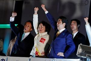 Japan's PM Shinzo Abe and Japan's Deputy Prime Minister Taro Aso (left) at an election campaign rally in Tokyo, on Oct 21, 2017.