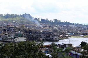 Damaged buildings are seen after government troops cleared the area from Marawi city, on Oct 23, 2017. More than 1,000 militants, government troops and civilians have been killed in the conflict so far.