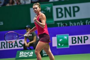 Simona Halep celebrates after winning against Caroline Garcia.