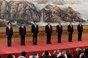 The Communist Party of China's new Politburo Standing Committee, (from left) Han Zheng, Wang Huning, Li Zhanshu, Chinese President Xi Jinping, Premier Li Keqiang, Wang Yang and Zhao Leji meet the press at the Great Hall of the People in Beijing.