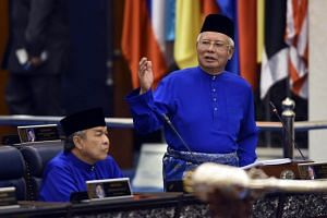 Malaysian Prime Minister Najib Abdul Razak (right) addresses the members of Parliament during the 2018 Budget presentation at the Parliament House in Kuala Lumpur on Oct 27, 2017.