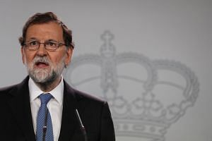 Rajoy delivers a statement after an extraordinary Cabinet meeting in Madrid, Oct 27, 2017.