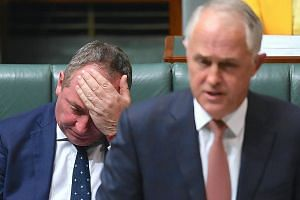 Australia's Deputy Prime Minister Barnaby Joyce, seen here seated behind Prime Minister Malcolm Turnbull in the House of Representatives at Parliament House in Canberra on Tuesday, was found by the High Court to be ineligible to be an MP as he was a