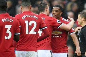 Manchester United's Anthony Martial (right) is congratulated by team mates following United's 1-0 win over Tottenham during an English Premier League soccer match at Old Trafford in Manchester, Britain, on Oct 28, 2017.