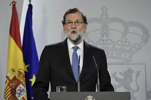 Spanish Prime Minister Mariano Rajoy gives a press conference after a cabinet meeting at La Moncloa Palace in Madrid.