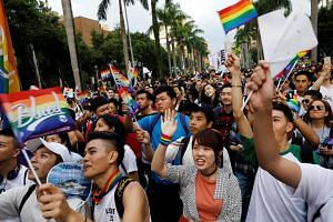 Participants react as they take part in a lesbian, gay, bisexual and transgender (LGBT) pride parade in Taipei, Taiwan, on Oct 28, 2017.