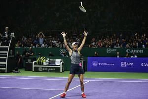 Caroline Wozniacki celebrating after defeating Venus Williams at the BNP Paribas WTA Finals Singapore on Oct 29, 2017.