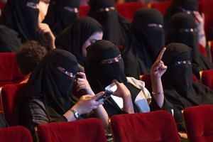 Saudi women attend a film festival on Oct 20, 2017, at King Fahad Culture Center in Riyadh.