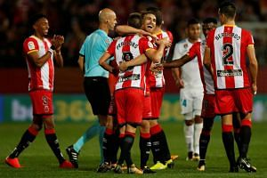 Girona players celebrate at the end of the Girona vs Real Madrid match at Estadi Montilivi, Girona, Spain on Oct 29, 2017.