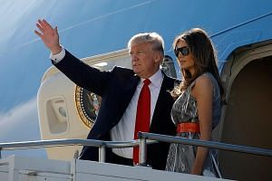 "President Donald Trump and his wife departing from Hamburg, Germany, in July. The First Lady will accompany him on ""at least part"" of the Asia trip, said the White House."