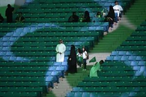 Saudi families arrive at a stadium to attend an event in the capital Riyadh on Sept 23, 2017 commemorating the anniversary of the founding of the kingdom.