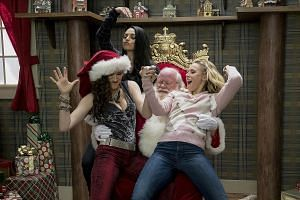 A Bad Moms Christmas stars (from left) Kathryn Hahn, Mila Kunis and Kristen Bell.