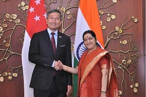 Dr Vivian Balakrishnan being welcomed by Ms Sushma Swaraj. Both ministers yesterday reviewed cooperation in defence and trade, among other areas.