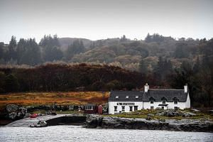 The boathouse cafe is seen across the water on the Isle of Ulva, off Scotland's west coast.