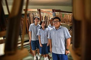 (From left) Fun Wei Yang, Tan Yu Xuan, Samia Afrin and Al Ezra Mohamed Al Johan are part of Ping Yi Secondary School's angklung ensemble, which plays Malay folk tunes as well as Chinese songs.