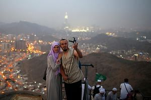 Muslim pilgrims taking photos at Mount Al-Noor near the city of Mecca, Saudi Arabia. Aside from the millions who travel to the kingdom for the haj pilgrimage, most visitors now face a tedious visa process and exorbitant fees.