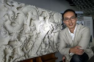 Dr Yeo Kang Shua, architectural conservator and lecturer from Singapore University of Technology and Design (SUTD) campus, with a 3D model of a Chinese temple sculpture that was produced in collaboration with SUTD assistant professor Stylianos Dritsa