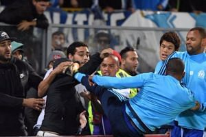 Former Manchester United left-back Patrice Evra evoked memories of Eric Cantona's gongfu kick at a Crystal Palace fan in 1995 with his karate kick aimed at a Marseille supporter.