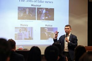 Mr Warren Fernandez, ST editor and editor-in-chief of Singapore Press Holdings' English/Malay/Tamil Media Group, speaking at the Digital Media Asia 2017.