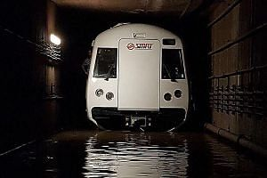 A train in the flooded tunnel between the Bishan and Braddell MRT stations on Oct 7. The flooding, caused by a gap in maintenance operations, disrupted North-South Line train services for about 20 hours.